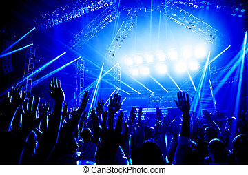 Rock concert, crowd of young people enjoying night...