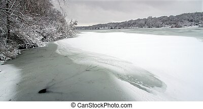 Shoreline of Pierce Lake on a snowy winter day at Rock Cut State Park in Illinois.