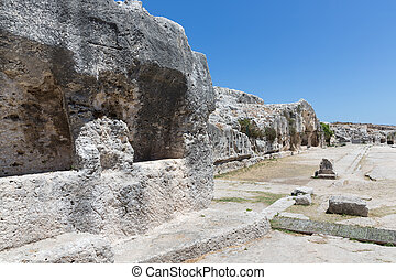 Rock dwellings at Archaeological Park Neapolis at Syracusa,...