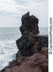 Rock end of Ponta do Sol pier bridge in Madeira