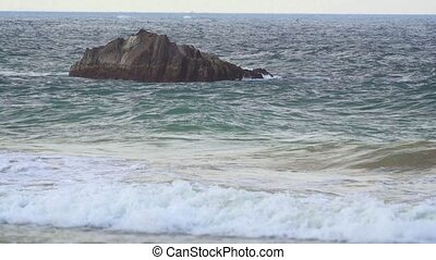 Rock Formation Juts from the Water near a Popular Beach -...