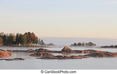 Rock formations and trees on a autumn morning in Vita Sannar...