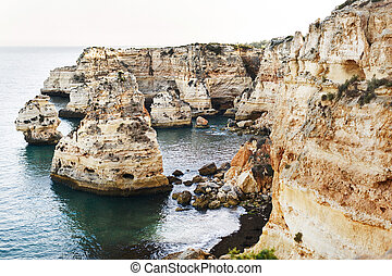 Rock formations near beach. Praia, Portugal
