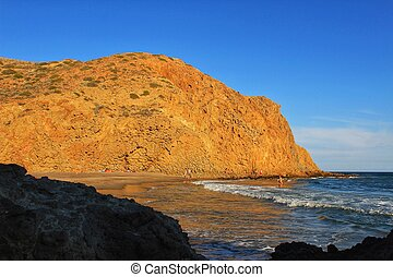 Rock formations on the beach in Almeria, Spain