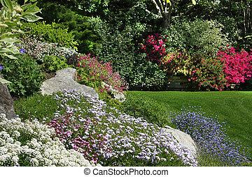 Rock garden - Flowering rock garden in spring. More images...