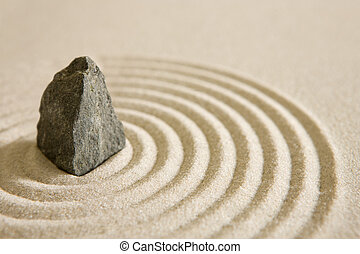 Rock garden - Rock surrounded by sand circles, zen concept