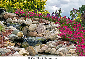 Rock Garden - Waterfalls in a summer rock garden.