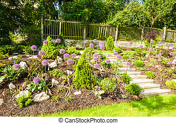 Rock garden with beautiful blooming kind of decorative...