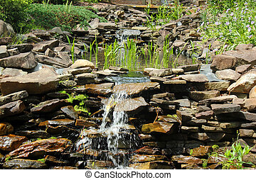 Rock garden with waterfall - Small waterfall in a rock...