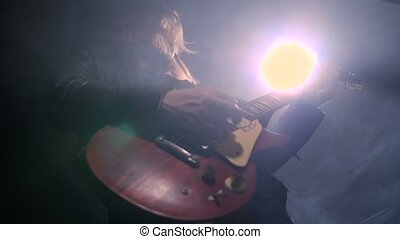 Rock guitarist playing guitar in recording studio - Bottom...