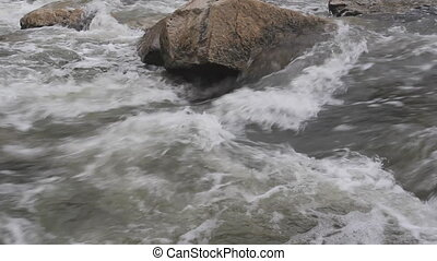 Rock in rushing river.