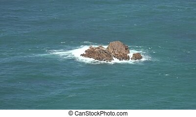 Rock Isle In Ocean Water