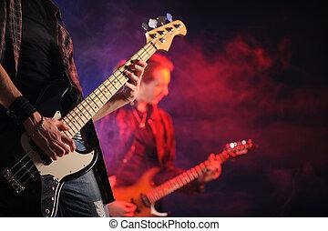 rock live concert - rock musicians playing at a live concert...