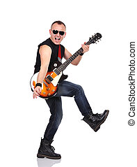 rock musician is playing on electrical guitar