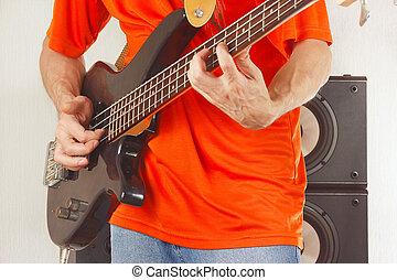 Rock musician playing bass guitar