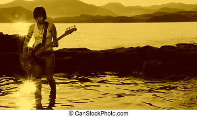 Rock musician. Sepia toned - Rock musician playing on the...