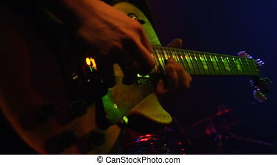 Rock n Roll guitar - This is a close up shot of a man...