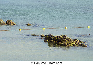 Rock on sea water