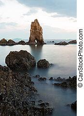 Rock on the beach over seacoast