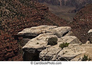Rock outcropping - A rock outcropping over a canyon.