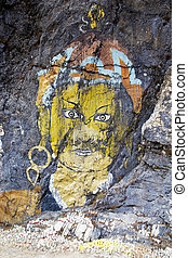 Rock painting, Bhutan - Votive offerings at the rock...