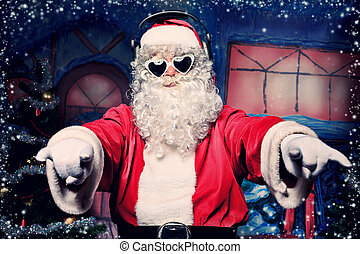 rock santa - Santa Claus is listening to music in...