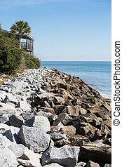 Rock Seawall and Deck of Coastal Home