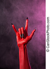Rock sign, red devil hand with black nails