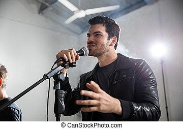 Rock singer singing at concert