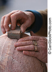 rock solid - shot of craftsman working stone the old...