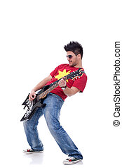 Rock star playing solo on guitar on a white background