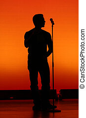 Sillouette of a musical performer.