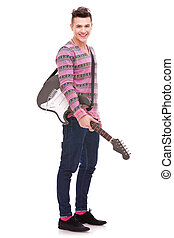 Rock star with an electric guitar smiling