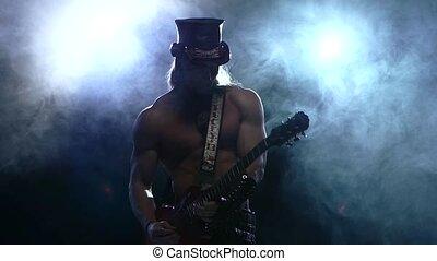 rock strip man playing bass guitar in studio