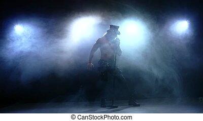 rock strip singer singing into a microphone, Slow motion, smoke