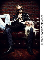 rock style couple - Passionate young woman lying on the lap...