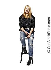 Rock style girl sitting on stool