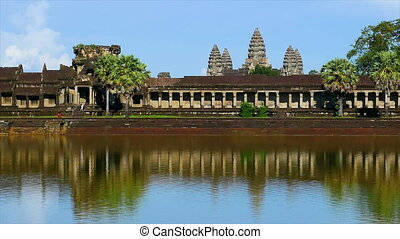 Rock temples and river - A wide shot of rock temples and...
