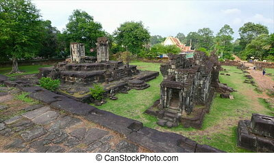 Rock temples and trees - A wide shot of temples built with...
