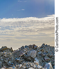Rock Wall Against Cloudy Sky Background