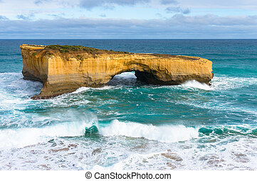 Rock with arch in the ocean