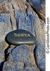 rock with balance written in gold.