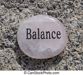 Rock with balance written on it.