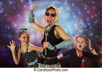 Rockabilly chicks - Rockabilly woman with her daughters...