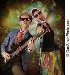 Rockabilly couple playing the guitar and singing
