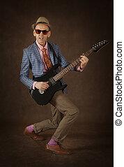 Rockabilly man playing the guitar