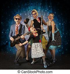 Rockabilly musician family - Rockabilly family band having...