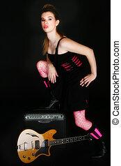 Rocker Chic - Beautiful Hispanic woman with electric guitar...
