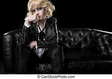 Rocker Girl with Sunglasses - Female in black leather and...
