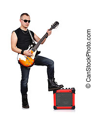 rocker - rock musician is playing electrical guitar and...